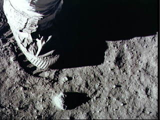 Astronaut steps onto the moon